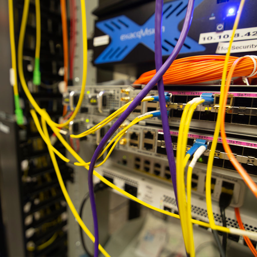 A close up shot of the fiber data network cables.