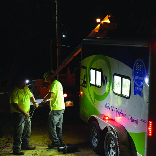 ImOn service technicians pulling fiber cable during maintenance window at night.