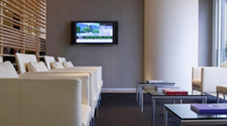 A view of the television and sitting area within a business waiting room.