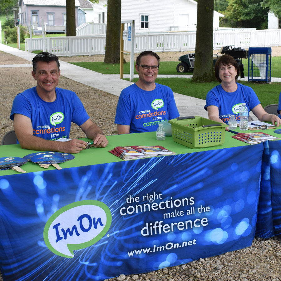 Circle-Image-ImOn--Employees-at-Carnival-Booth.jpg