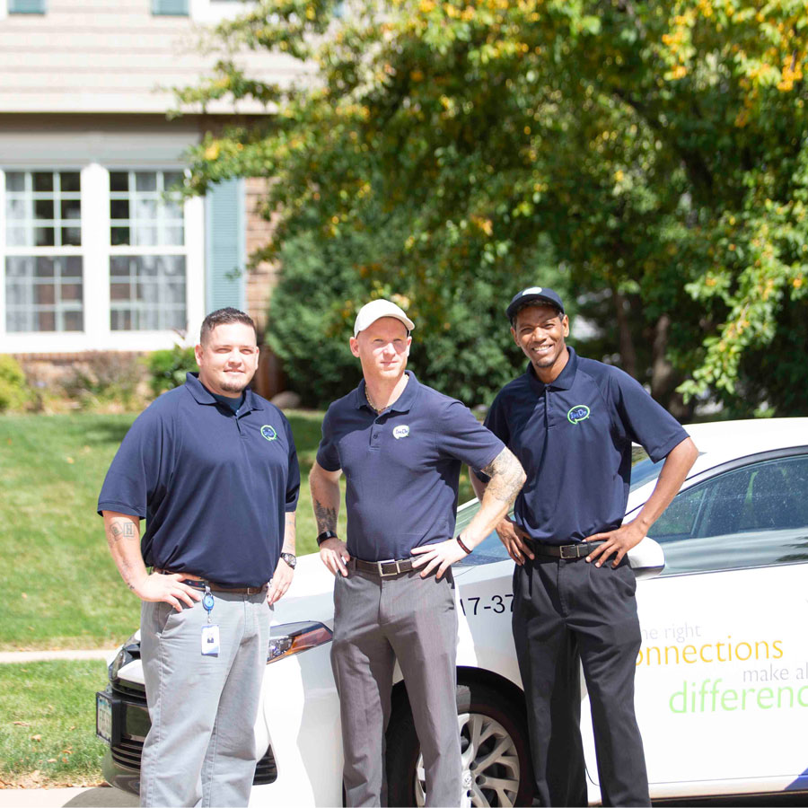 Three ImOn sales representatives standing by ImOn car parked in Cedar Rapids neighborhood.