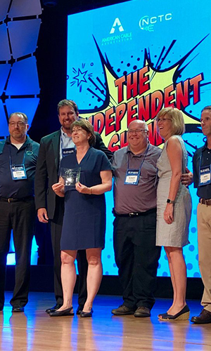 300x500-Thumbnail-Image-Patrice-and-employees-receiving-CableFax-Award-2018.png